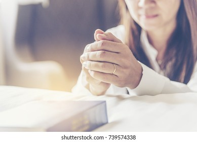 Holy bible prayer believe in god church. Woman hands pray christian bible for god blessing wishing better life. begging forgive and believe goodness. Christian life crisis prayer to god in church.
