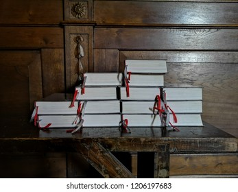 Holy bibles of Catholic Church liturgy on the wooden table.