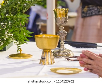 holy bread becomes body of Christ and holy wine becomes blood of Christ the savior of the sins of men in the hands of the priest during mass