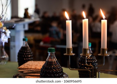 Holy communion with bread, vine, candles and blurry background
