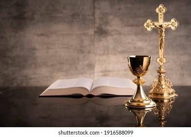 Holy communion. Catholic theme. Gray stone background.