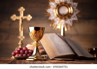 Holy communion. Catholic theme. Wooden background. Place for typography.