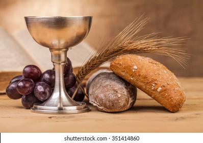 holy communion chalice on wooden table