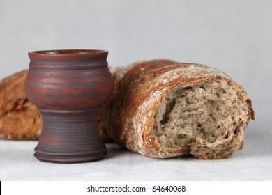 Holy communion. Chalice with wine and bread. Shallow dof, copy space