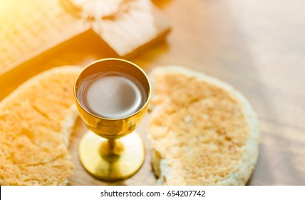 Holy communion, Good friday in church.Taking Communion.Cup of glass with red wine, bread and Holy Bible and Cross.The Feast of Corpus Christi Concept.holy communion worship church.Christian background