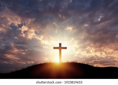 Holy concept: Silhouette wooden cross on  mountain sunset background