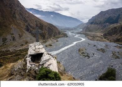 The holy cross in the Daryal Gorge, Kazbegi District, Mtskheta-Mtianeti Region, Georgia. The Darial Gorge is a river Terek gorge on the border between Russia and Georgia.