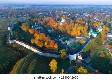 Holy Dormition Pskovo-Pechersky Monastery in Pechory in the golden autumn (shooting from a quadrocopter). Russia