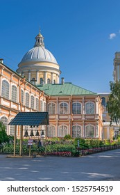 Holy Duchov Corps (Dukhov housing) of the Alexander Nevsky Lavra with a rose garden and bells and the  neoclassic dome of the Holy Trinity Cathedral