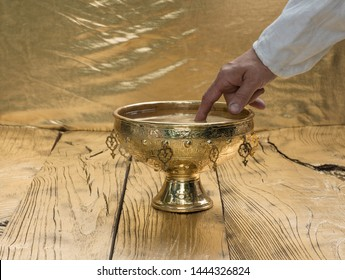 Holy Golden Grail  on golden wooden background