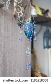 Holy grail. A fantasy medieval chalice cup of wine decorated with blue gemstones hanging for display