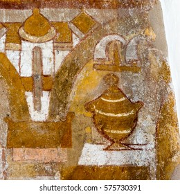 The holy grail on an altar, two horns and a byzantine church and a viking Temple. Medieval wall-painting in Skibet church, Denmark, October 27, 2015