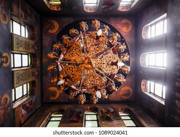 Holy Hand, Russia - June 24, 2017: The ceiling of the Orthodox church. Icons and frescoes in the saints. Decorated chandelier under the ceiling