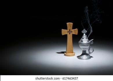 holy incense-burner, religion symbol  on dark background