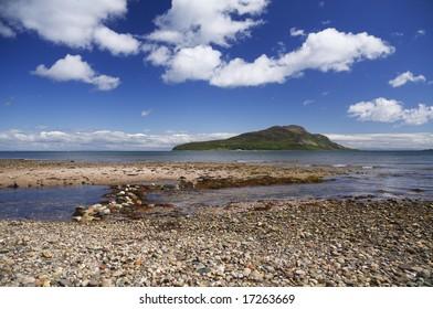 Holy Isle just off an Arran Beach in Scotland