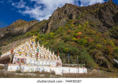 Holy pagodas in Tibet temple with colorful forest on mountain