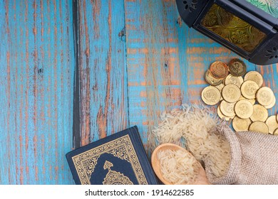 Holy Quran with arabic calligraphies translation meaning of Al-Quran, Coins, Rosary and Rice. Zakat concept. Zakat is a form of alm-giving as a religious obligation