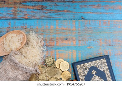 Holy Quran, Coins, Rosary and Rice. Zakat concept. Zakat is a form of alm-giving as a religious obligation