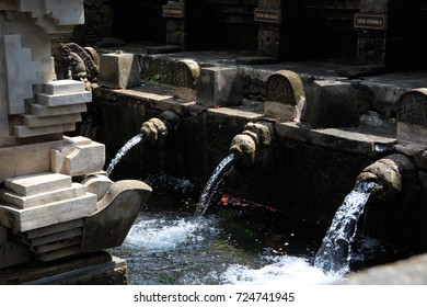 Holy Spring Water at Balinese Tirta Empul for people who want to clean themselves in Hindu's Believe.