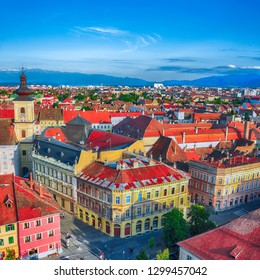 Holy Trinity Church and Council Tower in Sibiu city, view from the bell tower of St Mary Cathedral. Aerial cityscape of Sibiu town. Impressive morning scene of Transylvania, Romania, Europe