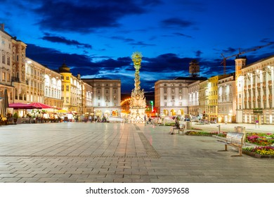 Holy Trinity column on the Hauptplatz or main square in the centre of Linz in Austria at sunset. Linz is the third largest city of Austria.