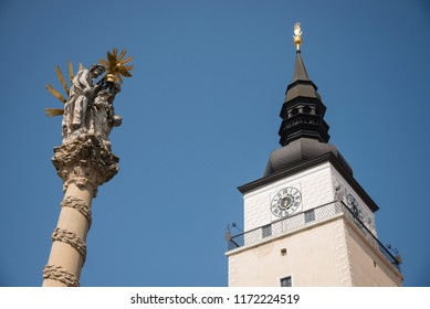 Holy Trinity Column and Town Tower in the center of Trnava city, Slovakia