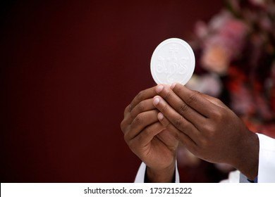Holy Wafer. Holy communion in church. Taking holy Communion. Priest celebrate mass at the church. Cup of glass with red wine, bread. Feast of Corpus Christi.
