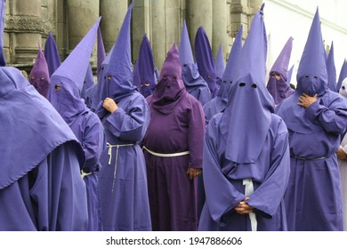 Holy Week in Quito Ecuador, Cucuruchos standing outside the church.