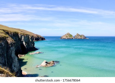 Holywell Bay Beach with crystal clear waters