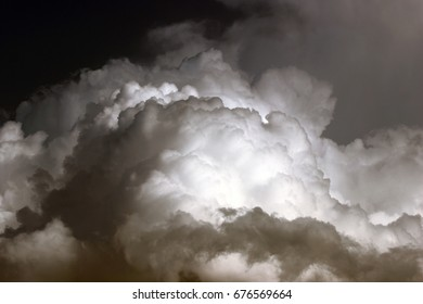 Homage to Ansel Adams, photography storm clouds, cottony, large, rising, cumulus nimbus, evaporation, growth, explode, portent, drama, fear,