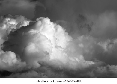 Homage to Ansel Adams, photography storm clouds in black and white, cottony, large, rising, cumulus nimbus, evaporation, growth, explode, portent, drama, fear,