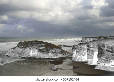 homage to Dalí, surrealistic photography, of   beach Cathedrals,Lugo,Galicia,Spain, abstract surrealism,Stone arches formed by the erosion dreams, landscape of dreams, photography of the subconscious,
