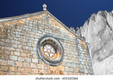 homage to Dalí, surrealistic photography, of Church of San Bartolomé, , Soria, Spain, natural park of the canyon of the river lobos, Romanesque rosette,photography of the subconscious,dreams photo,