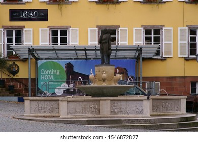 HOMBURG, GERMANY - OCTOBER 19: The fountain on the market square in front of a historic building and cafe on October 19, 2019 in Homburg.