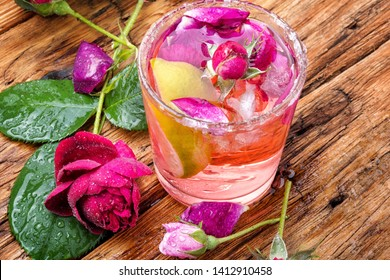 Home alcoholic drink from tea rose.Flower cocktail.Summer drink