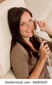 Home attractive smiling woman calling phone in living room