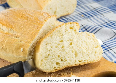 Home baked bread and a knife on the table