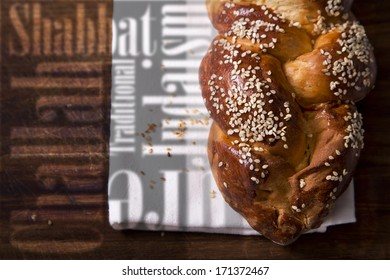 A home baked Challah loaf with writing