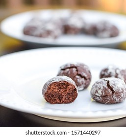 Home baked chocolate crinkle cookies in powdered sugar, Chocolate cookies with cracks served on a plate, selective focus