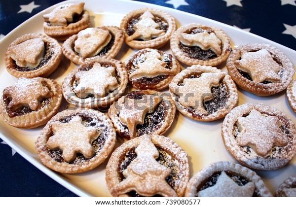 Home baked Christmas mince pies on a white tray