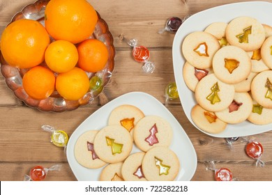 Home Baked Crystal Cookies On White Plates. Oranges, Clementines