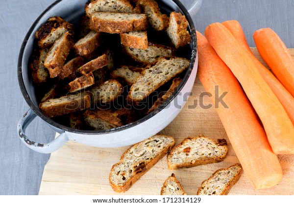 Home baked healthy ricotta baguettes with cheese and sun-dried tomato with carrots and garlic