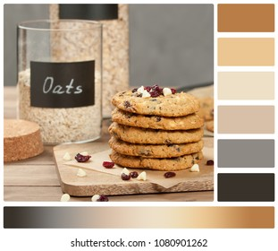 Home Baked Oatmeal Cookies With White Chocolate And Cranberries. Palette With Complimentary Color Swatches