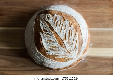 Home baked sourdough bread with scoring