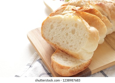 Home bakery French bread sliced on wooden board
