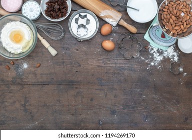Home baking kitchen setting with ingredients for bread and cup cakes