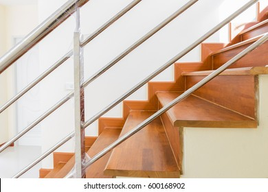 Home building interior empty room design staircase concrete top wood stainless steel handrails
