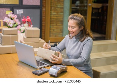 Home business concept,Young entrepreneur, teenager business owner work online shopping alpha generation life style.using digital tablets for video phone call receive from customer , happy surprise