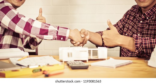 Home buying contract concept, Successful agreement , estate, buyer shaking hand in office
