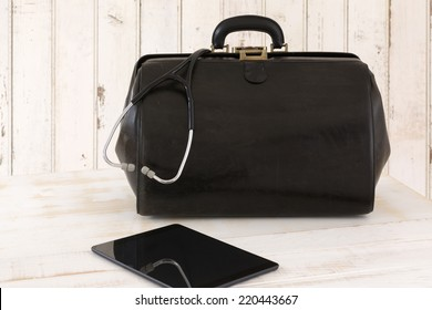 Home call, doctor's bag with stethoscope and Tablet